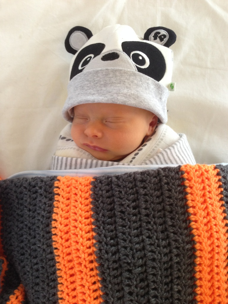 Judah - One week old in a bear hat