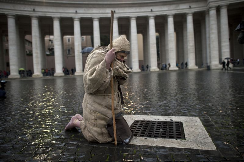 At Prayer in St Peter's Square in the Rain