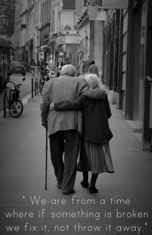 Old couple embrace
